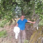A photo of Gavin under a pear tree